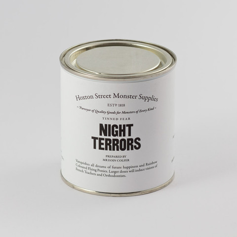 "Night Terrors, £8.00. Vanquishes all dreams of future happiness and Rainbow Coloured Flying Ponies. Larger doses will induce visions of French Teachers and Orthodontists. Contains sweets and ""Night Terrors"" by Eoin Colfer, a specially commissioned short story suitable for ages 9+ and exclusive to Hoxton Street Monster Supplies."